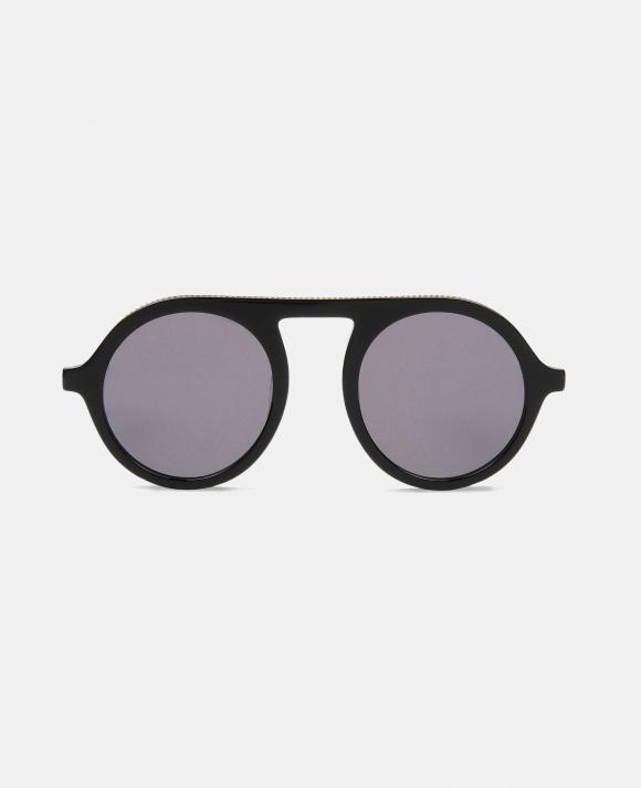cbd5e2fedb ... propuestas de gafas diminutas en grandes firmas, como Stella McCartney,  que las propone tanto redondas como de ojos de gato, pero con diferentes  tonos ...