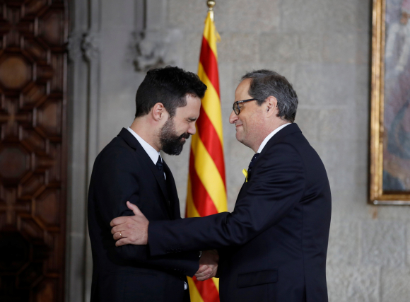 Roger Torrent y Quim Torra./EFE