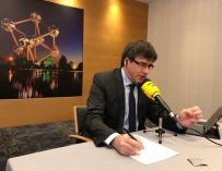 Carles Puigdemont durante la entrevista en Catalunya Radio