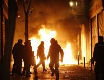 Contenedores incendiados en Lavapiés