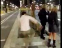 Fotografía de la agresión a una mujer en la Diagonal de Barcelona.
