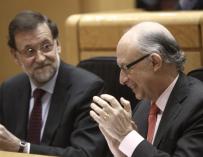 Rajoy junto con Montoro