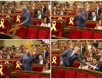fotografías del portavoz del grupo parlamentario de Ciudadanos, Carlos Carrizosa, retiró un lazo amarillo colocado en el banco del Govern,