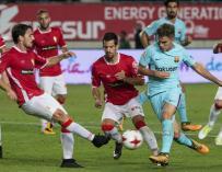 El Real Murcia, durante el encuentro de Copa del Rey ante el Barça de este curso. /EFE